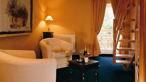 Hôtel Restaurant La Belle Vue Salon d'une chambre